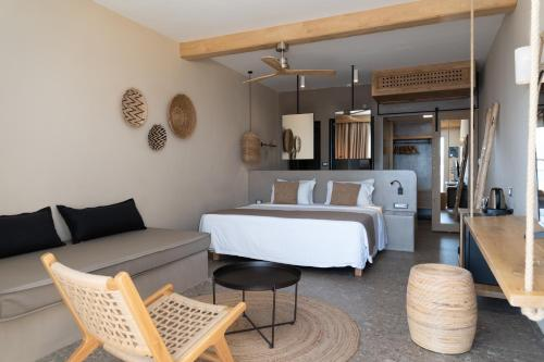A bed or beds in a room at Sea Side Resort & Spa