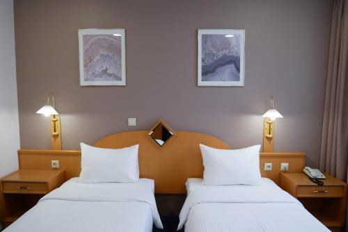 Кровать или кровати в номере ТрансОтель