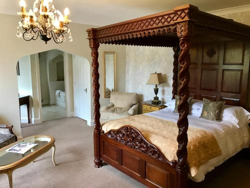 A bed or beds in a room at The Lake Country House Hotel & Spa