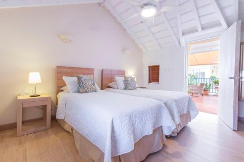 A bed or beds in a room at Posada La Fe by BespokeColombia