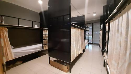 A bunk bed or bunk beds in a room at Bed Box Bali