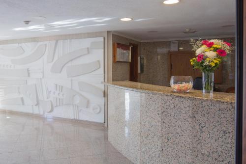 El vestíbulo o zona de recepción de Apartamentos Los Tilos
