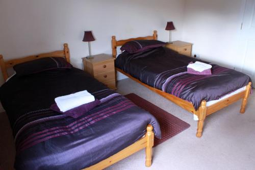 A bed or beds in a room at The Black Bull Inn