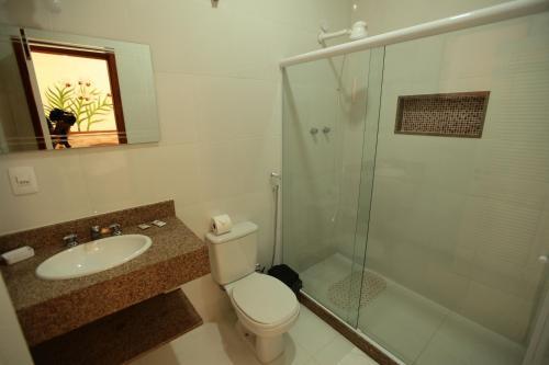 Um banheiro em POUSADA DAS ORQUIDEAS20