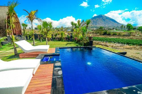The swimming pool at or near Batur Panorama