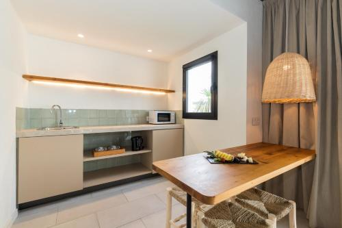 A kitchen or kitchenette at MarSenses Hotels Paradise Club & Spa