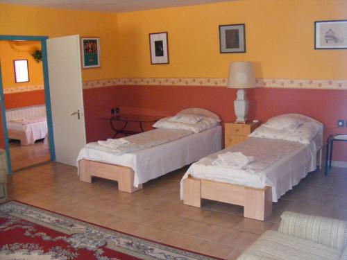 A bed or beds in a room at Hotel Pelikán