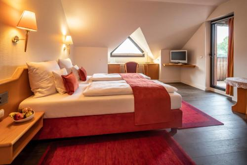 A bed or beds in a room at PANORAMA Hotel Heimbuchenthal