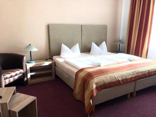 """Ein Bett oder Betten in einem Zimmer der Unterkunft Hotel """"Central"""" Jörg Krause"""