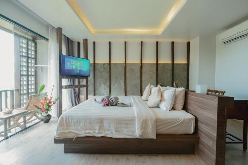 A bed or beds in a room at SriLanta Resort and Spa