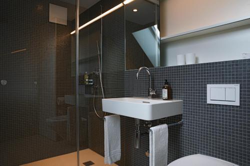 Ein Badezimmer in der Unterkunft Hotel Dom