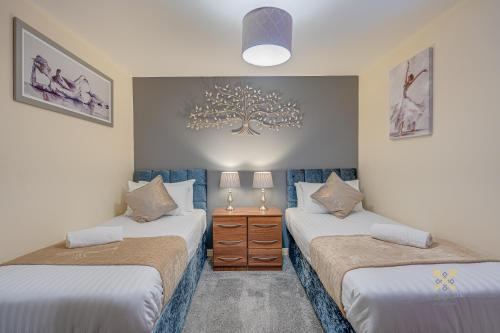A bed or beds in a room at Mica Point City Centre Apartment