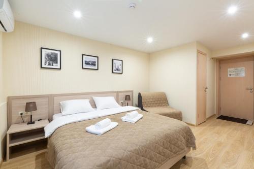 Кровать или кровати в номере Мини-отель Хамовники