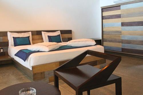 Ein Bett oder Betten in einem Zimmer der Unterkunft swp eco lodge