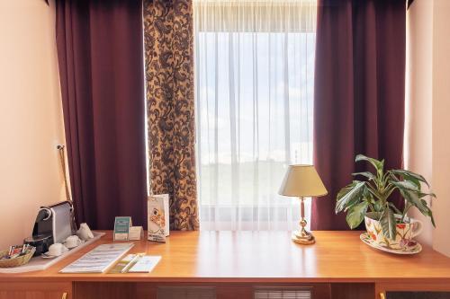 Гостиная зона в Отель Аструс Москва