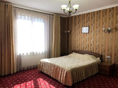 Кровать или кровати в номере Elbrusiya