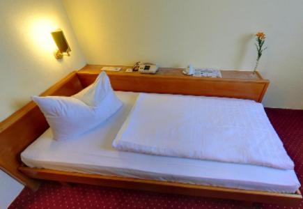 Кровать или кровати в номере Hotel Mondial