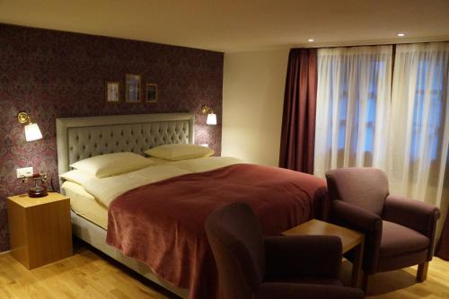 A bed or beds in a room at Hotel Walliserhof Zermatt