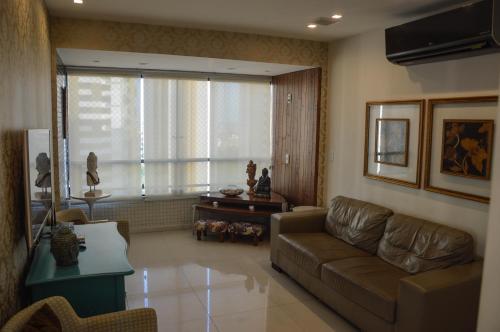 A seating area at Apartamento de Luxo no melhor bairro
