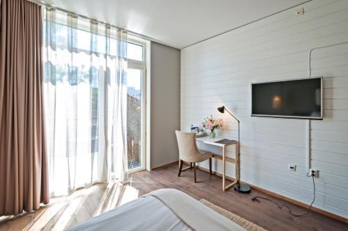 En tv och/eller ett underhållningssystem på Hotel no. 16