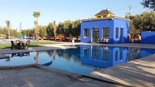 The swimming pool at or near Camping hotel elferdaous