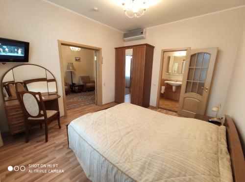A bed or beds in a room at Derzhavniy Hotel