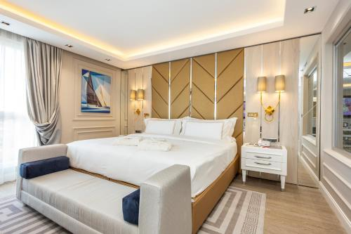 A bed or beds in a room at Ramada by Wyndham Sofia City Center