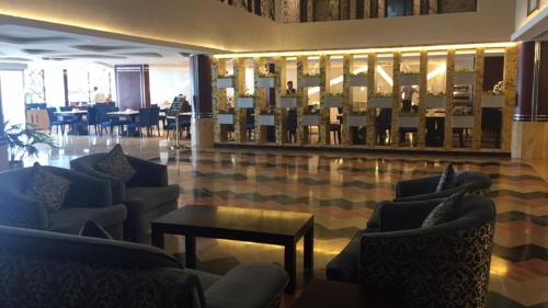 The lounge or bar area at Al Bustan Hotel