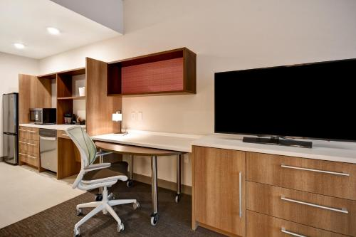 A television and/or entertainment center at Home2 Suites By Hilton Jekyll Island