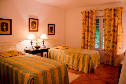 A bed or beds in a room at Ribatejo Villa
