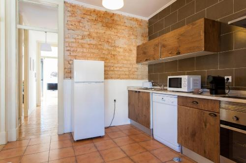 A kitchen or kitchenette at Beato Apartments