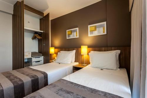 A bed or beds in a room at RioStay Residence - Riocentro