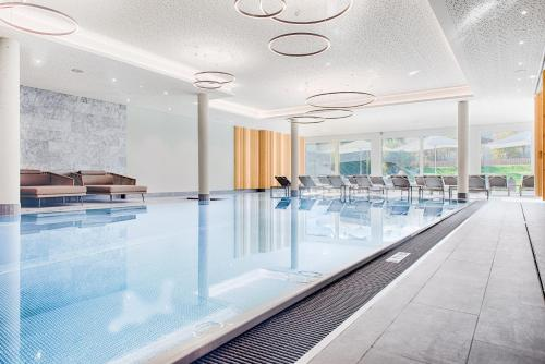 The swimming pool at or near Obermühle 4*S Boutique Resort