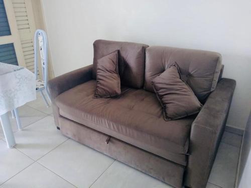 A seating area at Apto. n. 208 no Cond. Cumaru