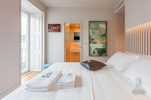 A bed or beds in a room at ON/SET Alfama - Lisbon Cinema Apartments