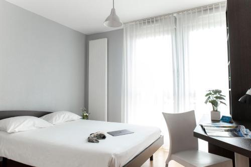 Un ou plusieurs lits dans un hébergement de l'établissement Zenitude Hôtel-Résidences Les Hauts Du Chazal