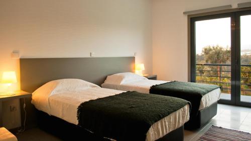 Uma cama ou camas num quarto em Casa de Vila Cete