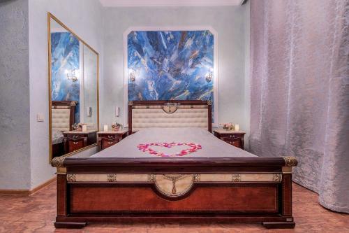 Кровать или кровати в номере Алекс Отель на Васильевском Острове