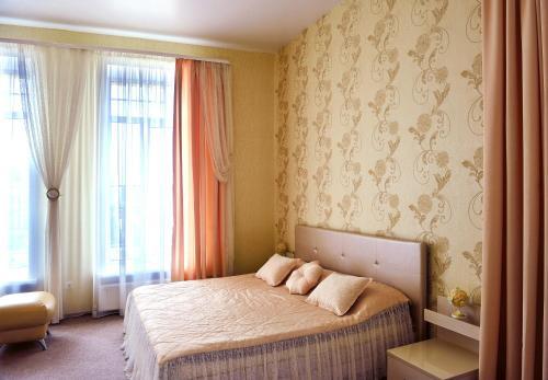 Кровать или кровати в номере Россия отель