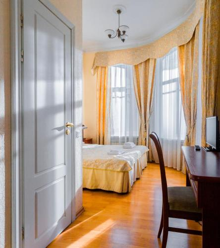 A bed or beds in a room at Baskov