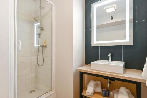 Salle de bains dans l'établissement Appart'City Confort Lille Grand Palais