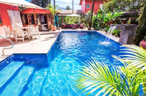 The swimming pool at or near Pousada Palmeira Imperial
