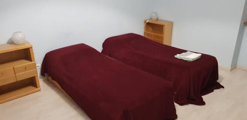 A bed or beds in a room at iride