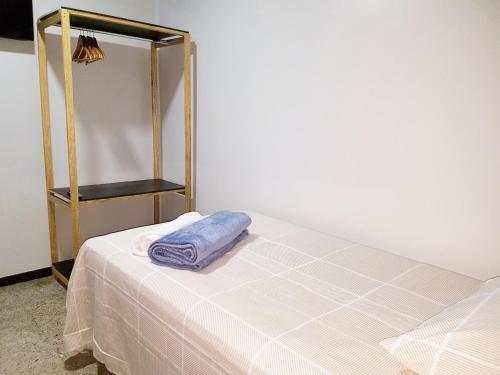 A bed or beds in a room at Pousada Vitória da Vila