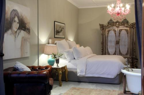 A bed or beds in a room at The Gregoire Boutique Villa