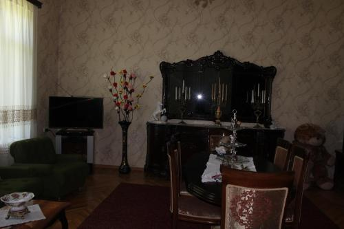 A television and/or entertainment center at Giorgi's Homestay