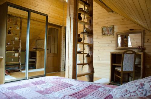 A bed or beds in a room at Mini-hotel Oasis
