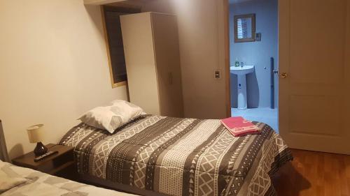 A bed or beds in a room at El Rincón de Vicente