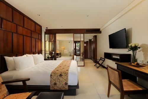 A television and/or entertainment centre at Padma Resort Legian