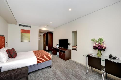 A television and/or entertainment center at Mercure Centro Port Macquarie